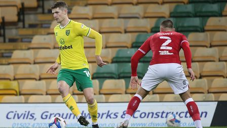 Jacob Sorensen of Norwich and Jack Hunt of Bristol City in action during the Sky Bet Championship ma