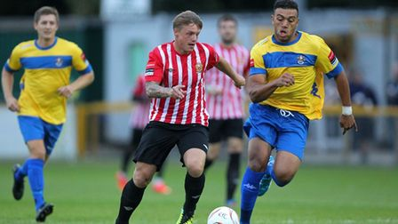 George Purcell of Hornchurch tries to escape Romford's Nathan Cooper, who would eventually become a teammate