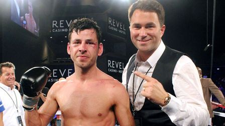 Darren Barker celebrates winning the world title with Eddie Hearn (pic: Lawrence Lustig)
