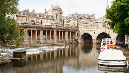 Pulteney Bridge in Bath, Somerset, UK. There are cruise boats in the right