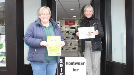 Tanya Marriott, left, and Sharon Flanagan from Portishead Easter Trail print sponsors Reeds Rains.