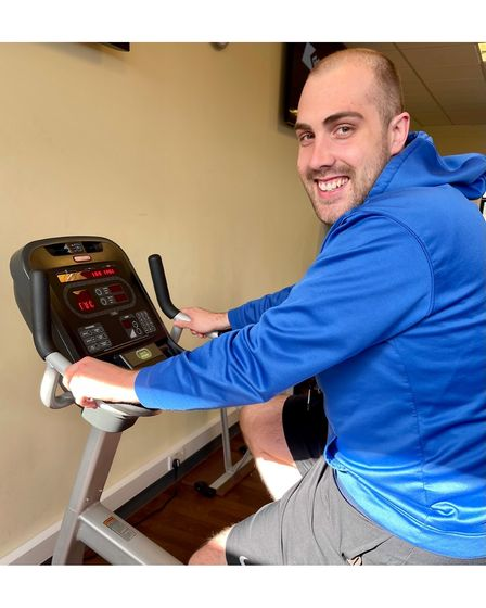 Adam Lewis on the exercise bike
