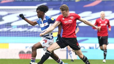 Reading's Ovie Ejaria (left) and Queens Park Rangers' Rob Dickie battle for the ball during the Sky