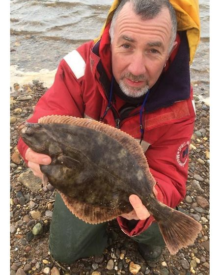 Andy Browning with a 1lb 10oz flounder from the Exe
