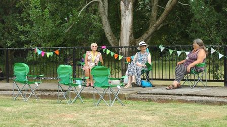 people sat in the park, socially distanced