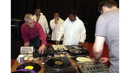 Simon Limbrick, head of music at Holywells High School with three pupils at a rapping and scratching workshop in 2005
