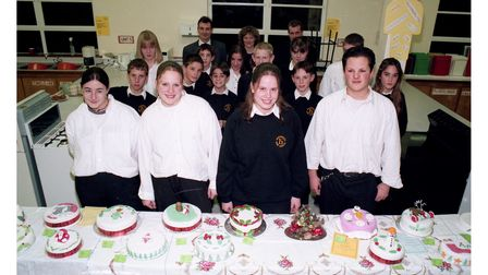 Students enjoying a day of decorating Christmas cakes at Holywells High School circa 1996