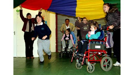 Holywells High school pupils organised a Christmas party for disabled children in 2006