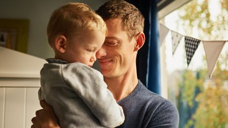 Divorced dad spends time with son following co-parenting custody arrangements