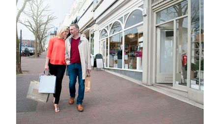A man and woman on a shopping street in Tunbridge Wells, Kent