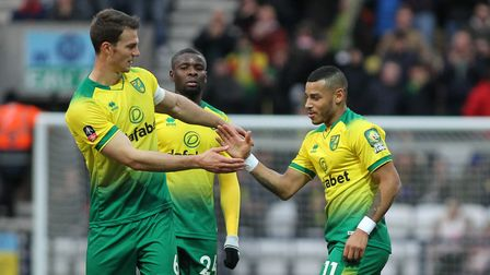 Onel Hernandez of Norwich City celebrates with Christoph Zimmermann after scoring the second goal ag