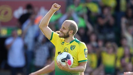 Hat trick hero Teemu Pukki of Norwich celebrates victory at the end of the Premier League match at C
