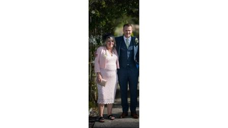 Mum and son together in a wedding picture
