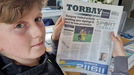 Boy reading his favourite newspaper