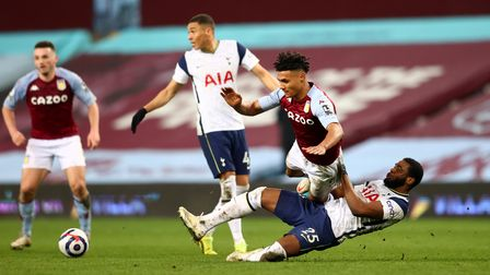 Tottenham Hotspur's Japhet Tanganga (right) and Aston Villa's Ollie Watkins (left) battle for the ba