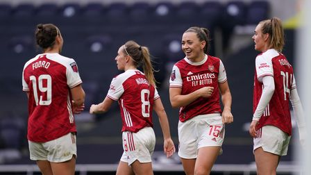 Arsenal's Katie McCabe (second right) celebrates scoring their third goal of the match with teammate