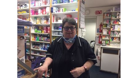 Pharmacy worker in shop with uniform on
