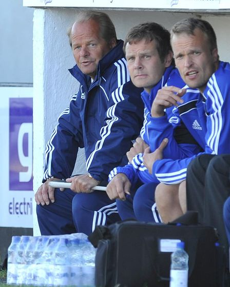 HJK Helsinki coach Antti Muurinen (left) sits with his staff during the UEFA Champions League Second