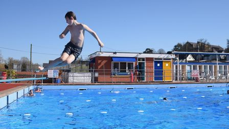 Joseph Audus, eight, jumps and twists into the pool as Beccles Lido reopens. Picture: DENISE BRADLEY