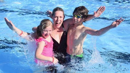 Charlotte Burrell with her children, Harriet, six, and Callum Sutton, 12, enjoying the pool as Beccl