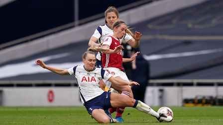 Arsenal's Jordan Nobbs is tackled by Tottenham Hotspur's Kit Graham (left) during the FA Women's Sup