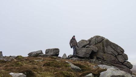 An intrepid walker at the second Wards Stone trig point