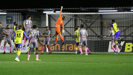 Wealdstone goalkeeper Harry Isted makes a save away to Solihull Moors