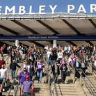 Fans make their way down the steps of Wembley Park Tube Station before making their way down Wembley