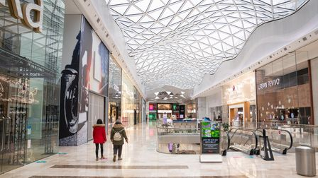 People walk through a near empty Westfield shopping centre in London during England's third national
