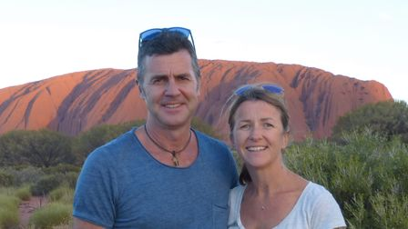 Devon couple Sid and Sara Heaslip pictured on their travels in front of Uluru, Australia.