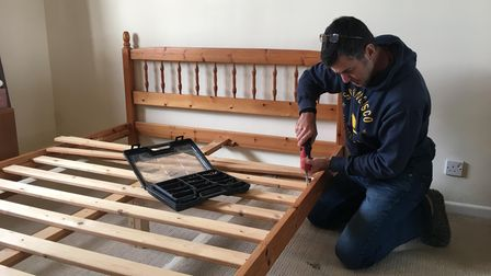 Devon freecycle expert Sid Heaslip putting together a bed.
