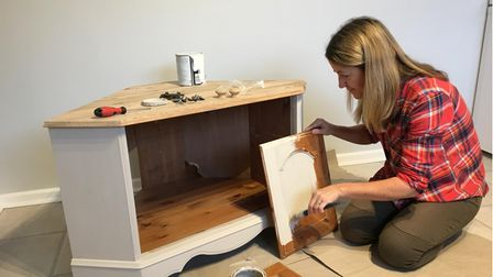 Devon freecycle expert Sara Heaslip painting second hand furniture.