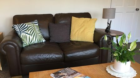 A black leather sofa bought for free by a Devon couple who are experts at freeycling.