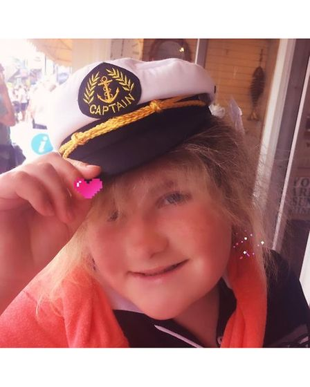 Carlotte Reid, who suffers with a brain tumour, on Wear a Hat Day in Sidmouth