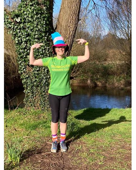 Alexa Baker donning a hat to raise funds for Brain Tumour Research