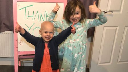 Lily and her sister say thank you to all those who donated