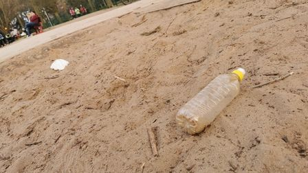 Plastic bottle in children's play area