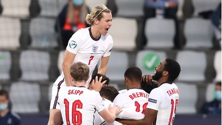 England's Curtis Jones (hidden) celebrates scoring their side's second goal of the game with team-ma