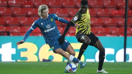Norwich midfielder Todd Cantwell tackles goal-scorer Ismaila Sarr during Watford's 1-0 win at Vicara