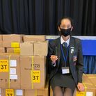 Student Sonna Panesar sitting on boxes