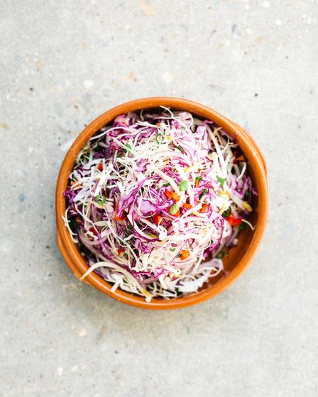 A ceramic bowl of cabbage slaw