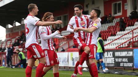 Stevenage celebrate after Tom Pett opened the scoring in the 3-1 win over Carlisle United.