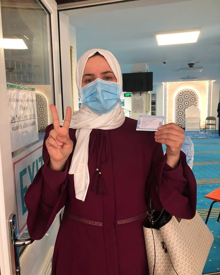 People that were vaccinated at London Colney Islamic Centre on April 1 posed for the V for #Vaccination campaign