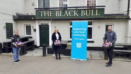 Donna AtkinLandlady of theBlack Bull inGodmanchester, Victoria Hurst charity trustee and James Knock, Co-op store manager.