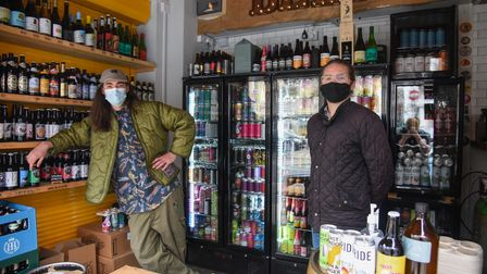 Joseph Marks, beer salesman, and Dominic Burke, co-owner, from Sir Toby's Beers stall working at CJ'
