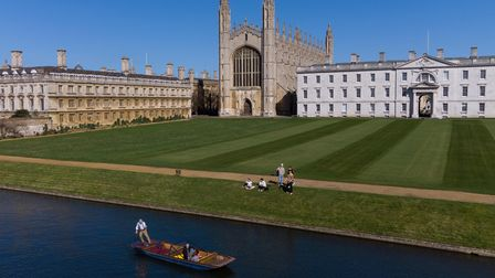 People enjoy a punt tour along the River Cam in Cambridge, on Monday, March 29, 2021.