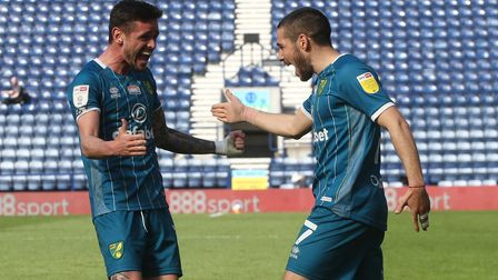 Emi Buendia celebrates his goal with Xavi Quintilla in Norwich City's 1-1 Championship draw against Preston