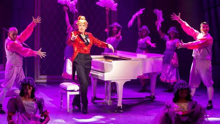 Paul Laidlaw as Dame Dotty Derriere at the piano in 2019 pantomime Beauty and the Beast at the Gordon Craig Theatre.