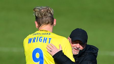 Gary Johnson Manager of Torquay United hugs goal scorer, Danny Wright of Torquay United after the N