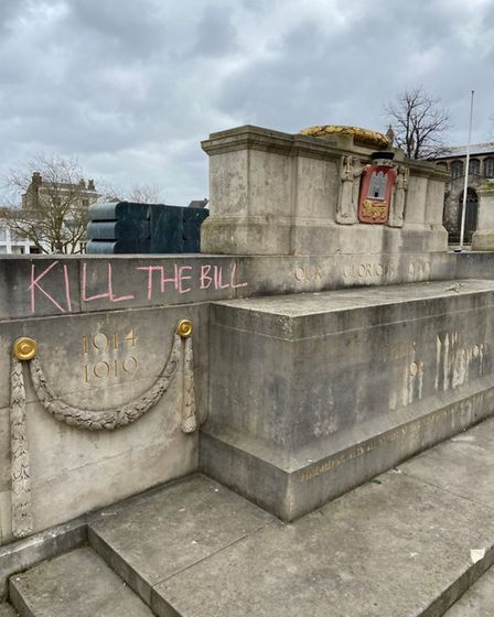 Slogan written on Norwich war memorial during protest against crime and policing bill.